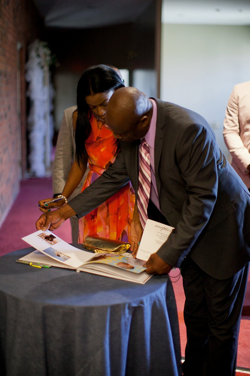 wedding-guests-signing-guestbook